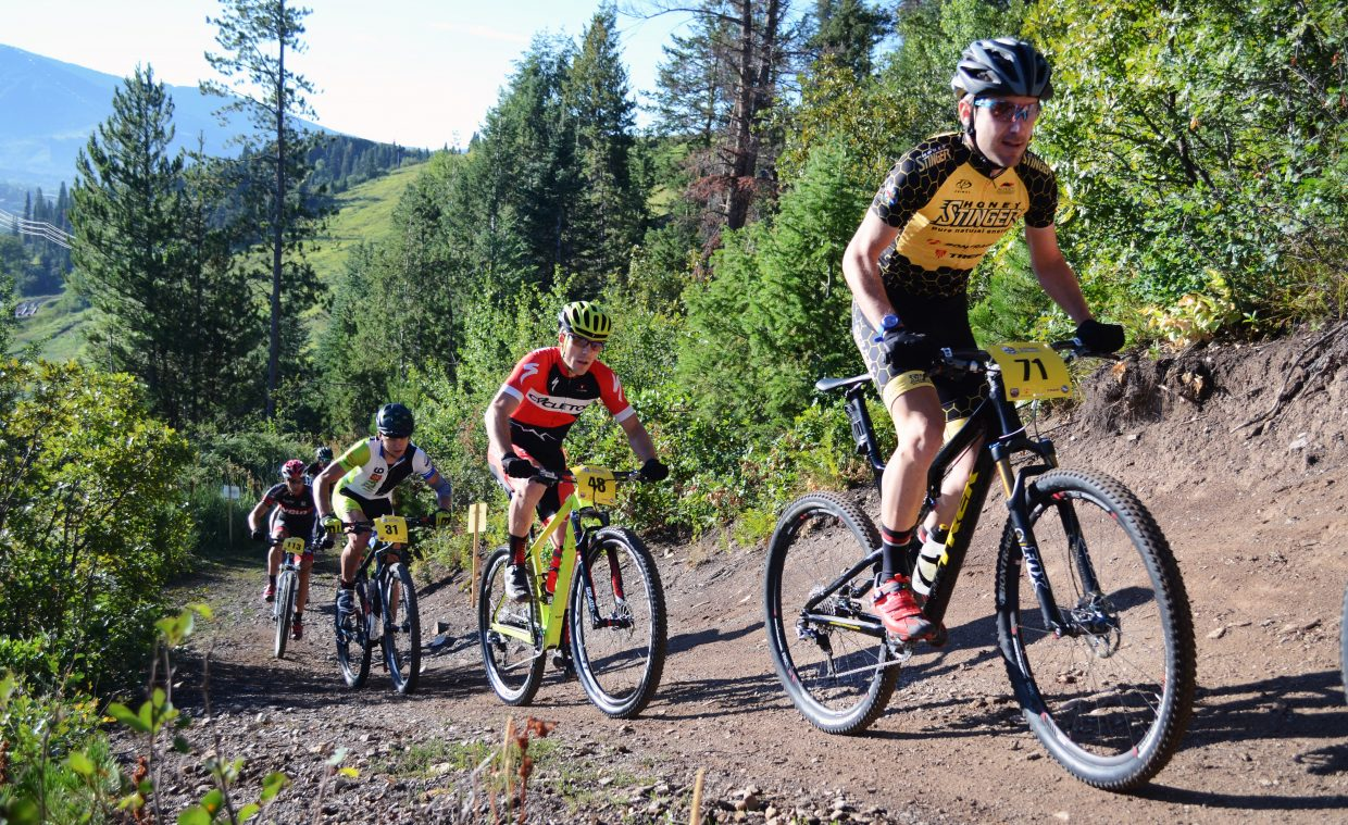 Denver Honey Stinger's Kelly Magelky works his way up Emerald Mountain early on in the men's pro-open class.