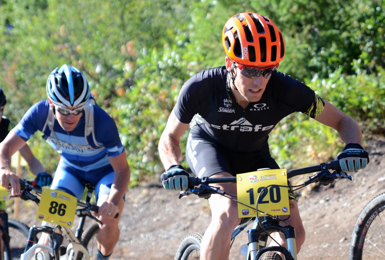 Mike Shea, of Carbondale, fights through a bottlenecked crowd on a steep Emerald Mountain slope Saturday during the fourth annual Steamboat Stinger mountain bike race.