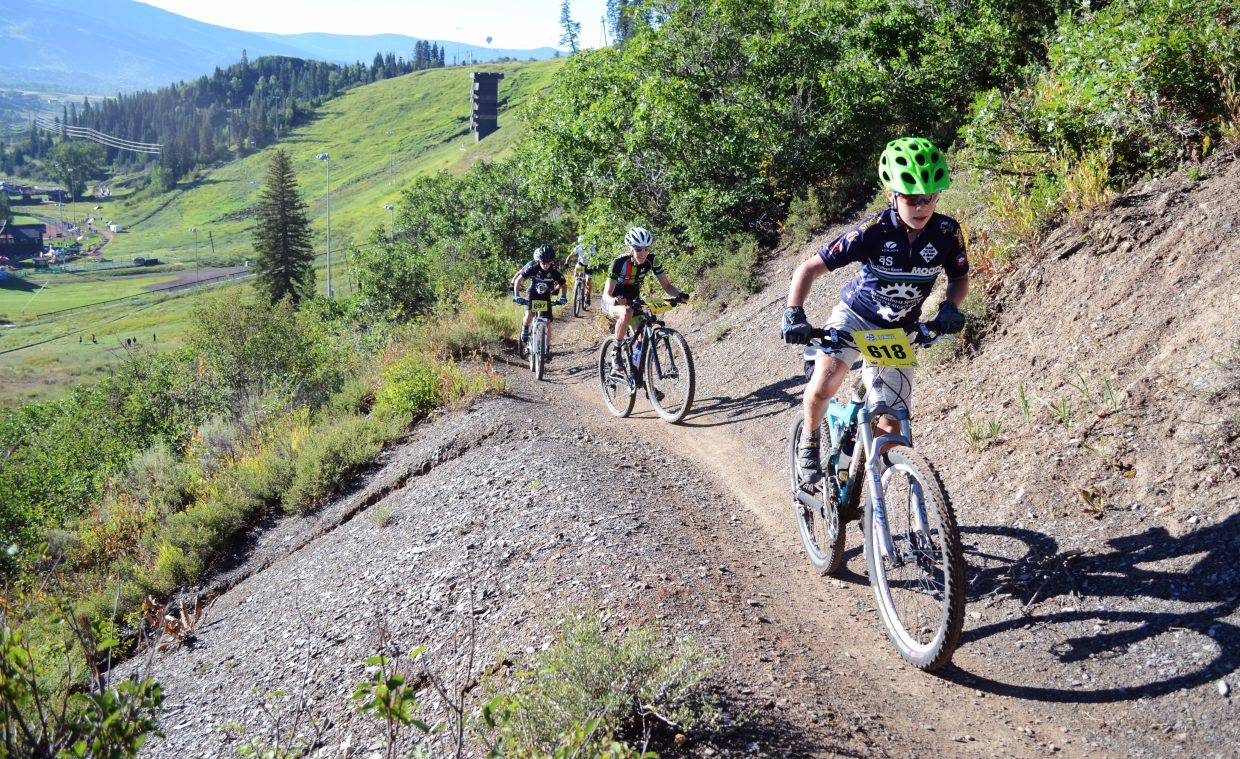 Chase Seymour races up Emerald Mountain during the men's duo class in Saturday's Steamboat Stinger mountain bike race.