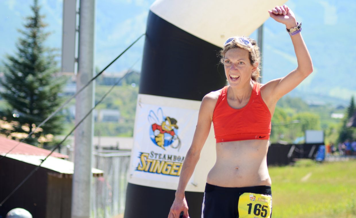 Katherine O'Donnell pumps her fist after finishing third in the Steamboat Stinger women's full trail marathon Sunday.