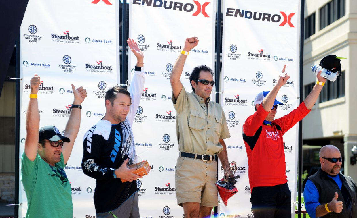 Rishi Grewal, center, was the Summit-X men's 40-plus winner and claimed the overall best time Sunday as the International Mountain Bicycling Association World Summit during the weekend came to a close.