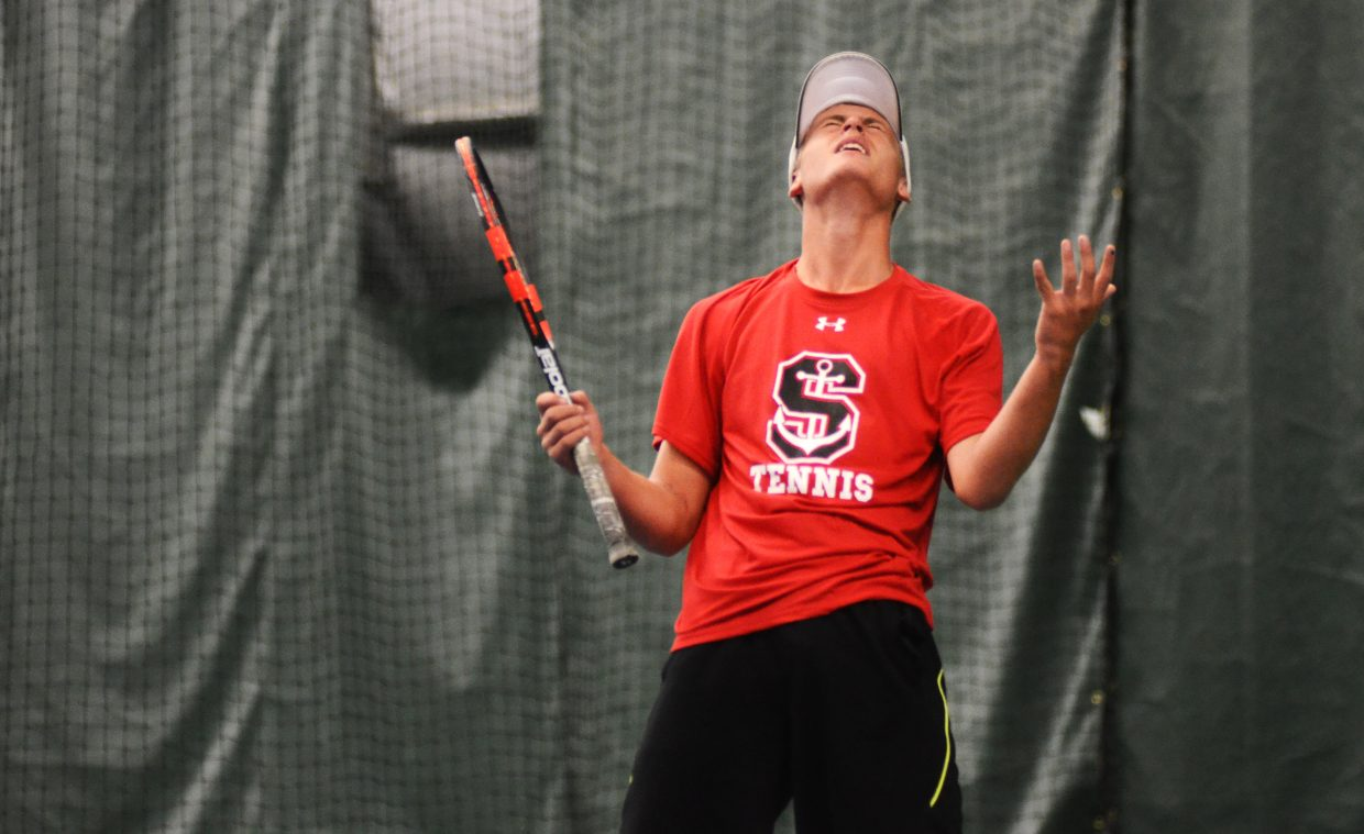 Steamboat No. 1 singles player Troy De Jong reacts after missing on a return shot Saturday against Poudre's Tyler Wilkinson. De Jong went on to win the match, 6-4, 6-3.