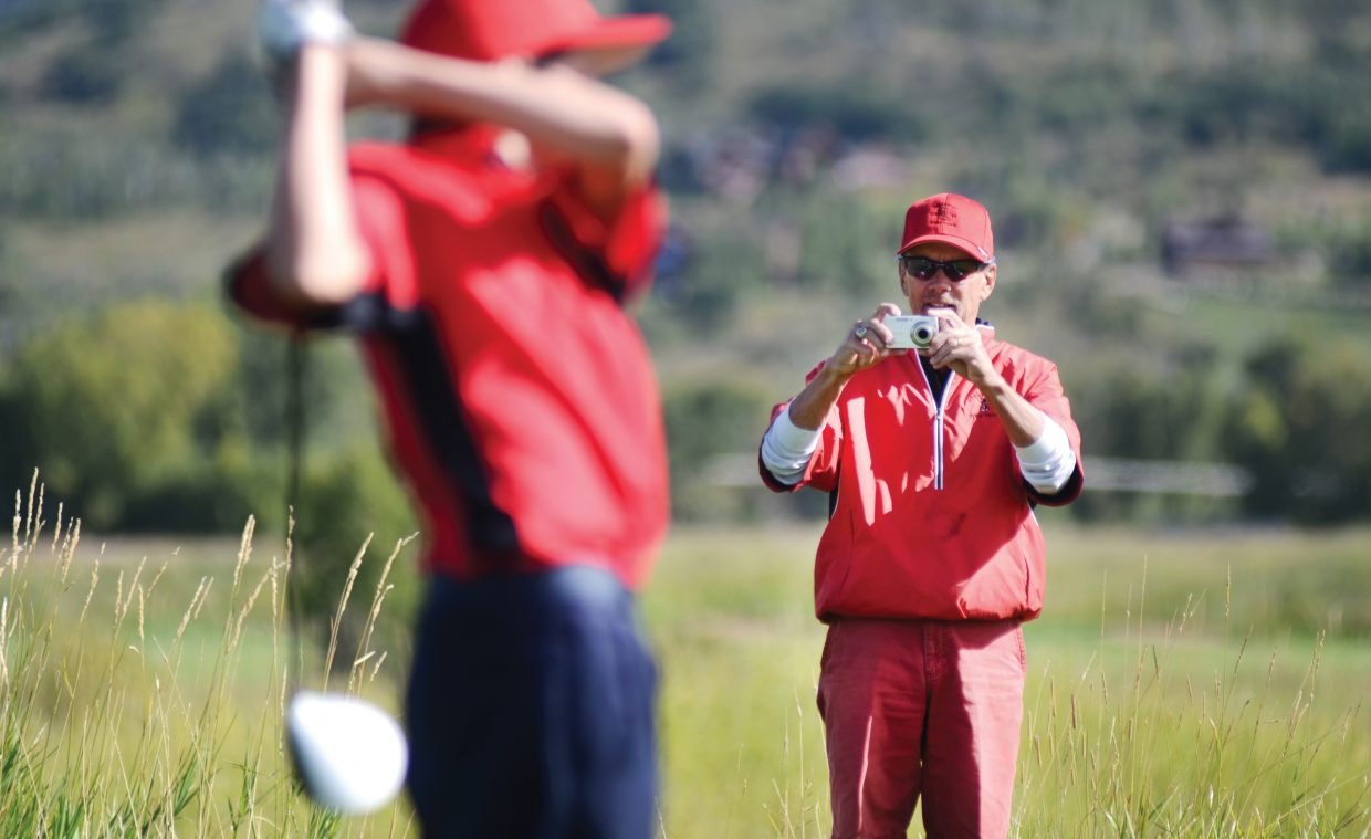 Outgoing Steamboat Springs High School golf coach Steve Dodson takes a photograph during a home tournament this season. Dodson announced that he is not going to return as head coach next year.