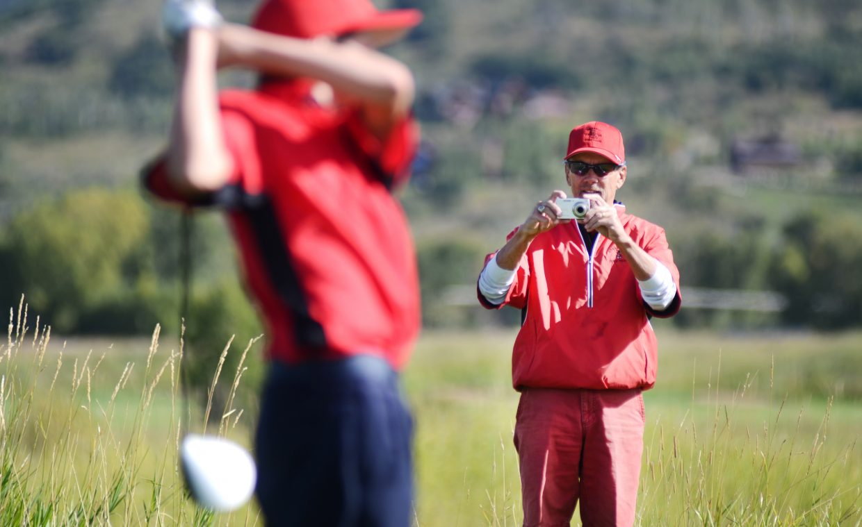 Steamboat Springs High School golf coach Steve Dodson captures a junior varsity player's drive on his camera Thursday at Haymaker Golf Course. Dodson's team won the Sailor Invitational by 29 strokes.