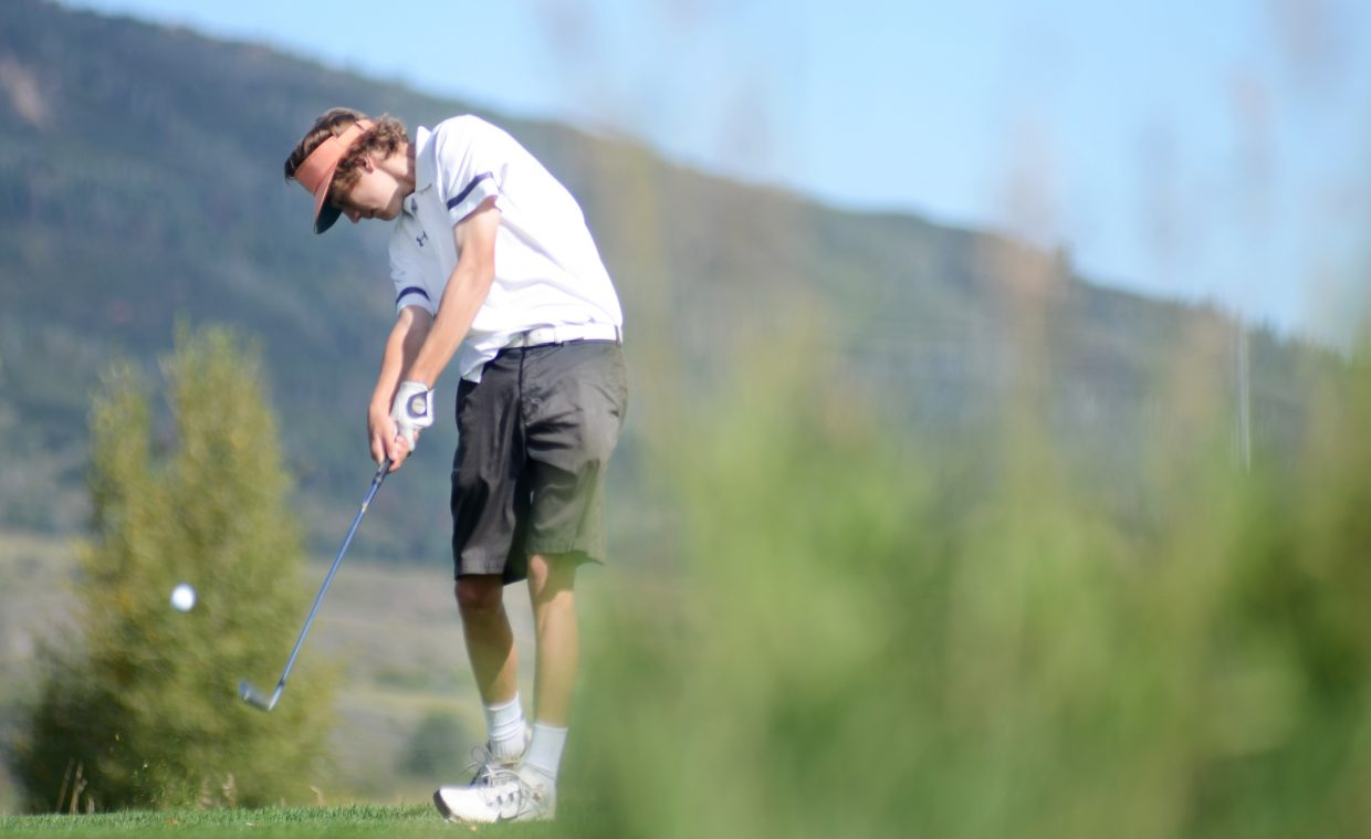 Steamboat Springs High School senior golfer Andrew Firestone tees off on the front nine at Haymaker Golf Course on Thursday during the Sailor Invitational. The entire Sailors varsity team shot in the 70s in its only home match of the season.