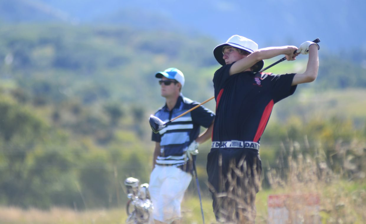 Steamboat Springs High School senior player Brandon Martin rips a drive Thursday at Haymaker Golf Course. The team dominated its only home match of the season, winning the Sailor Invitational by 29 strokes.