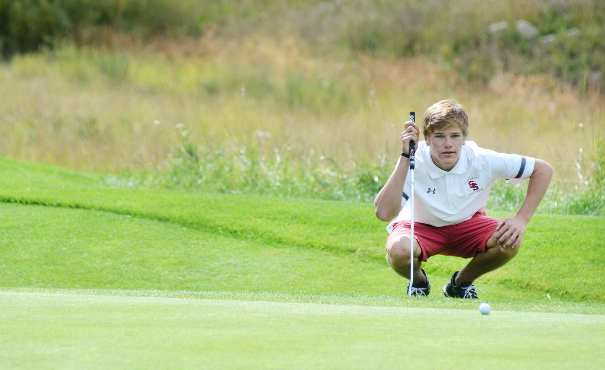 Steamboat Springs High School junior golfer Britt Walton lines up a putt on No. 9 at Haymaker Golf Course on Thursday. Walton shot a 76, helping the Sailors win their home match to close out the regular season.