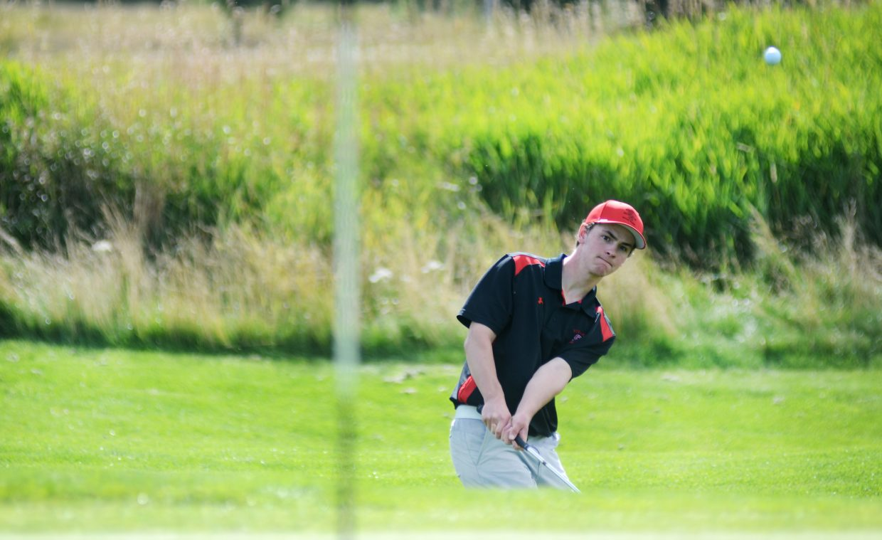Steamboat Springs High School junior varsity player Drew Williamson chips out of the rough and onto the green Thursday at Haymaker Golf Course. Williamson and the Sailors' JV squad impressed in the home invitational.