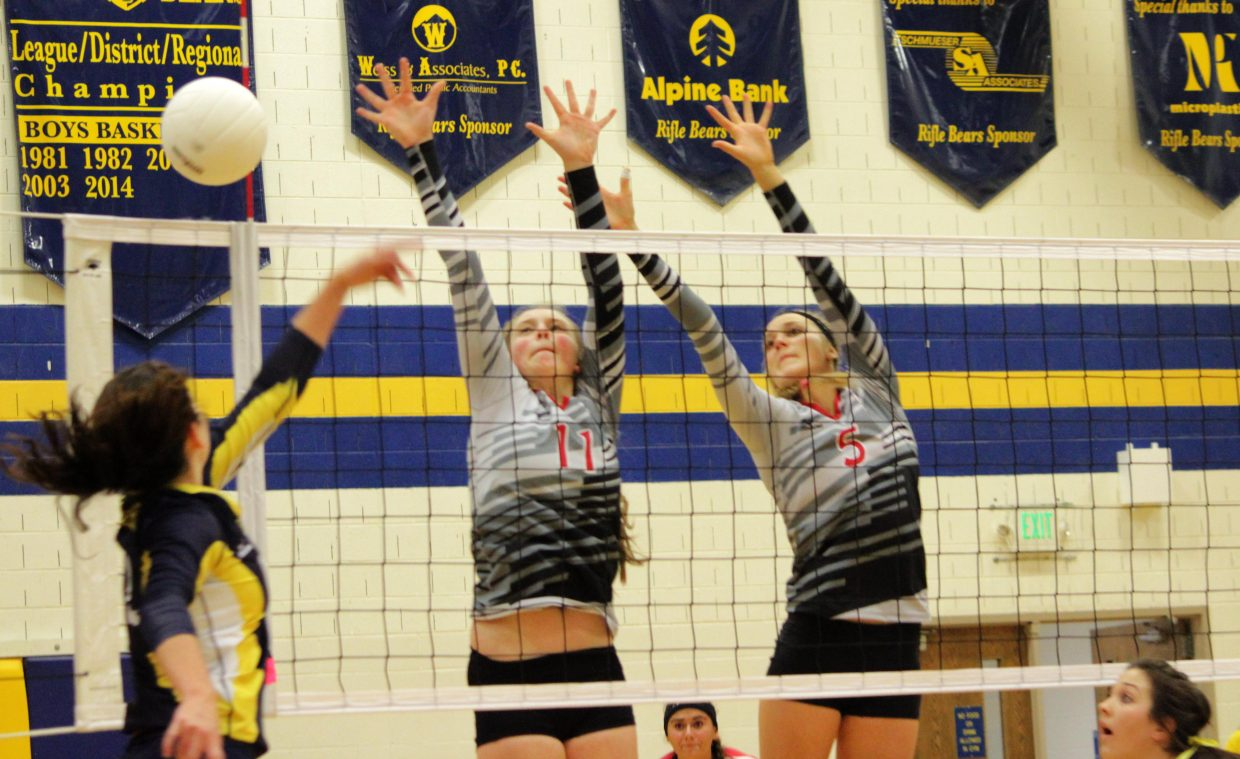 Steamboat Sailors Annie Osbourn, 11, and Taylor Harrington, 5, stretch out for a block against Rifle on Saturday. Steamboat dominated the match, winning in three sets to improve to a perfect 8-0.