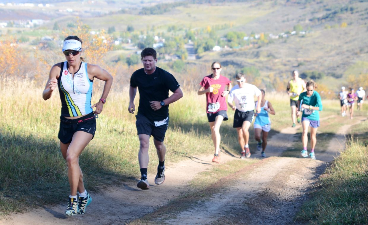 Steamboat's Heather Gollnick starts to break away from an early pack during the Emerald Mountain Trail Run Saturday morning. Gollnick won the women's 12K and ended up being the Steamboat Springs Running Series' overall women's champion.