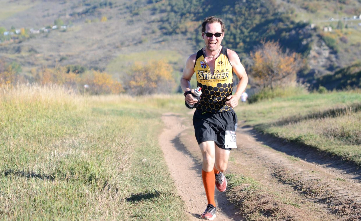 Harry Niedl, the Steamboat Springs Running Series' four-time men's champion, makes a steady climb in the early going of the Emerald Mountain Trail Run Saturday morning.