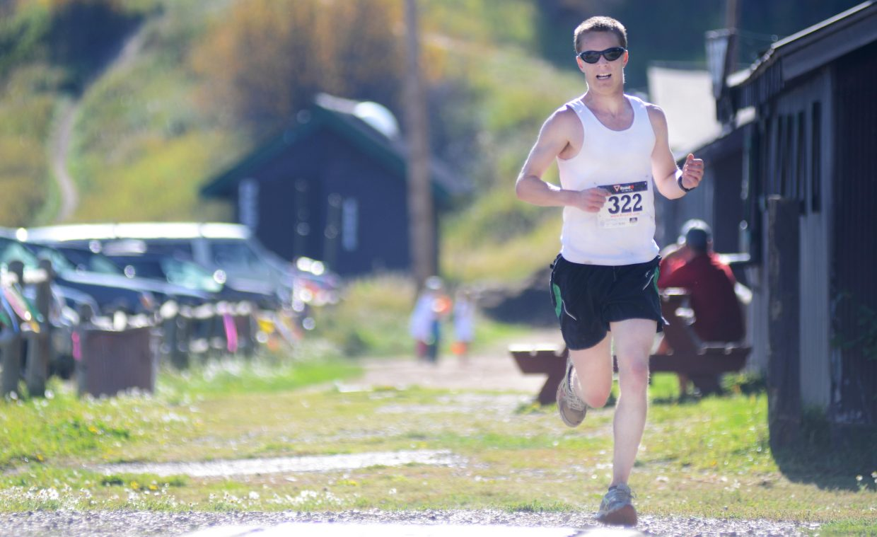Watkins Fulk-Gray springs to the finish Saturday morning at the Emerald Mountain Trail Run. Fulk-Gray won the men's 12K.