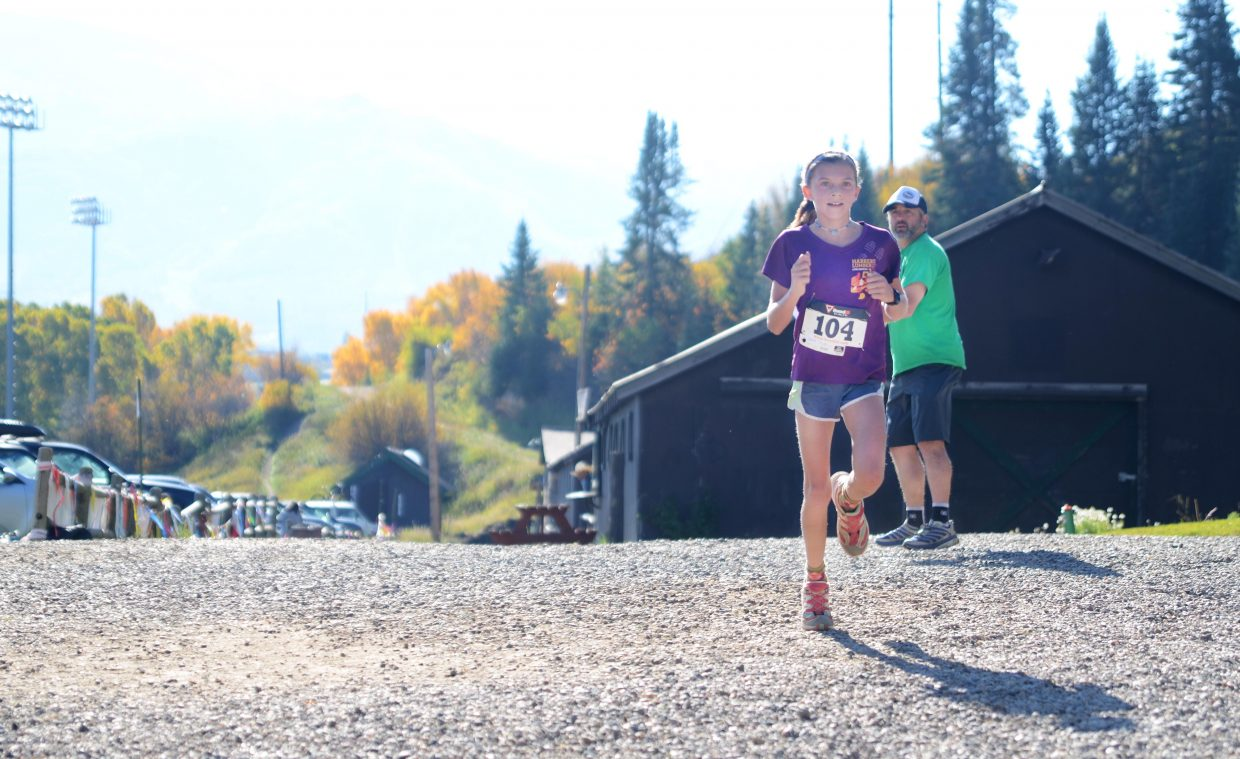 Maggie Congdon heads toward her first-place finish in the women's 5K during Saturday morning's Emerald Mountain Trail Run.