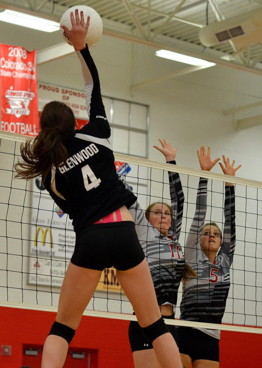 Steamboat Springs' Annie Osbourn, No. 11, and Taylor Harrington, No. 5, get up to block a hit from Glenwood Springs' Makena Warren in the Sailors' 3-0 victory Saturday. Steamboat is a perfect 10-0 after a pair of wins this weekend and could be ranked in the new CHSAA polls this week.