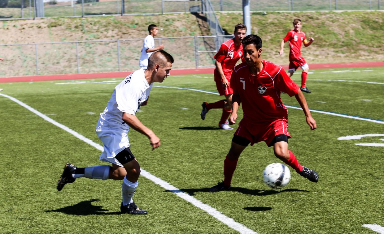 Steamboat's Hector Lopez applies some pressure against Palmer Ridge on Saturday. The Sailors won the game, 3-2, to improve to 4-2-1.