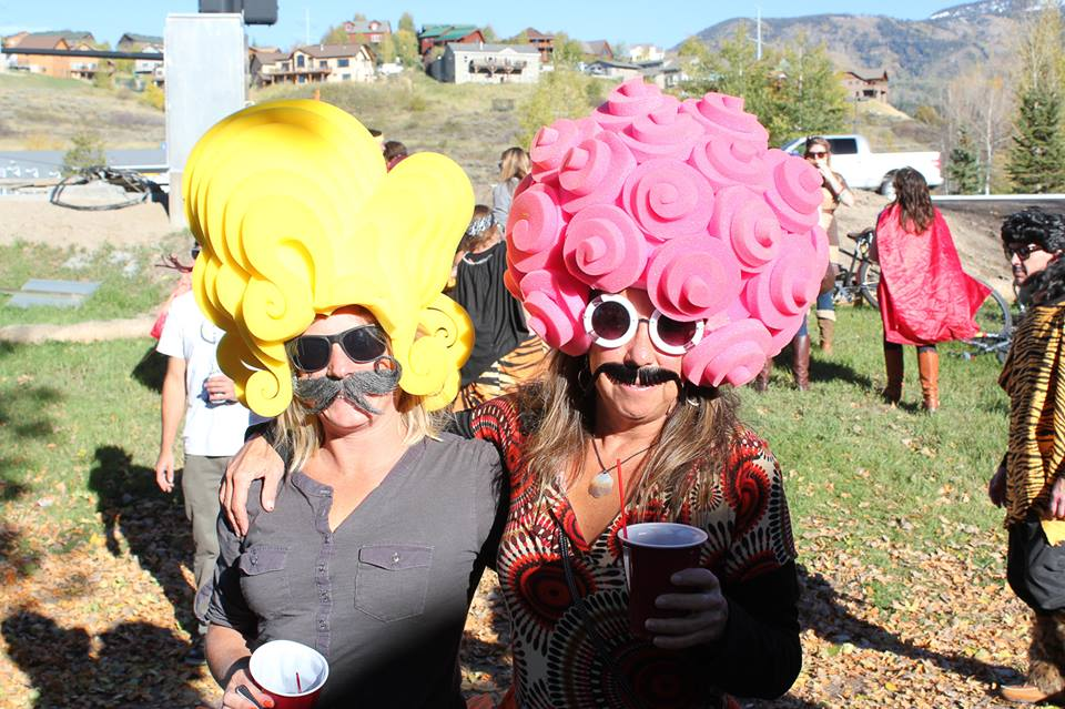 Michele Beck and Tammy McDermott pose for a photo at last weekend's Mustache Ride outside of Freshies, the second stop on the ride. The event raised over $11,000 for the Routt County Humane Society.