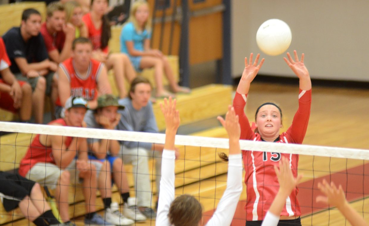 Steamboat Springs' Jenna Miller taps over a hit Saturday in the Sailors' 3-0 win at home against Delta.