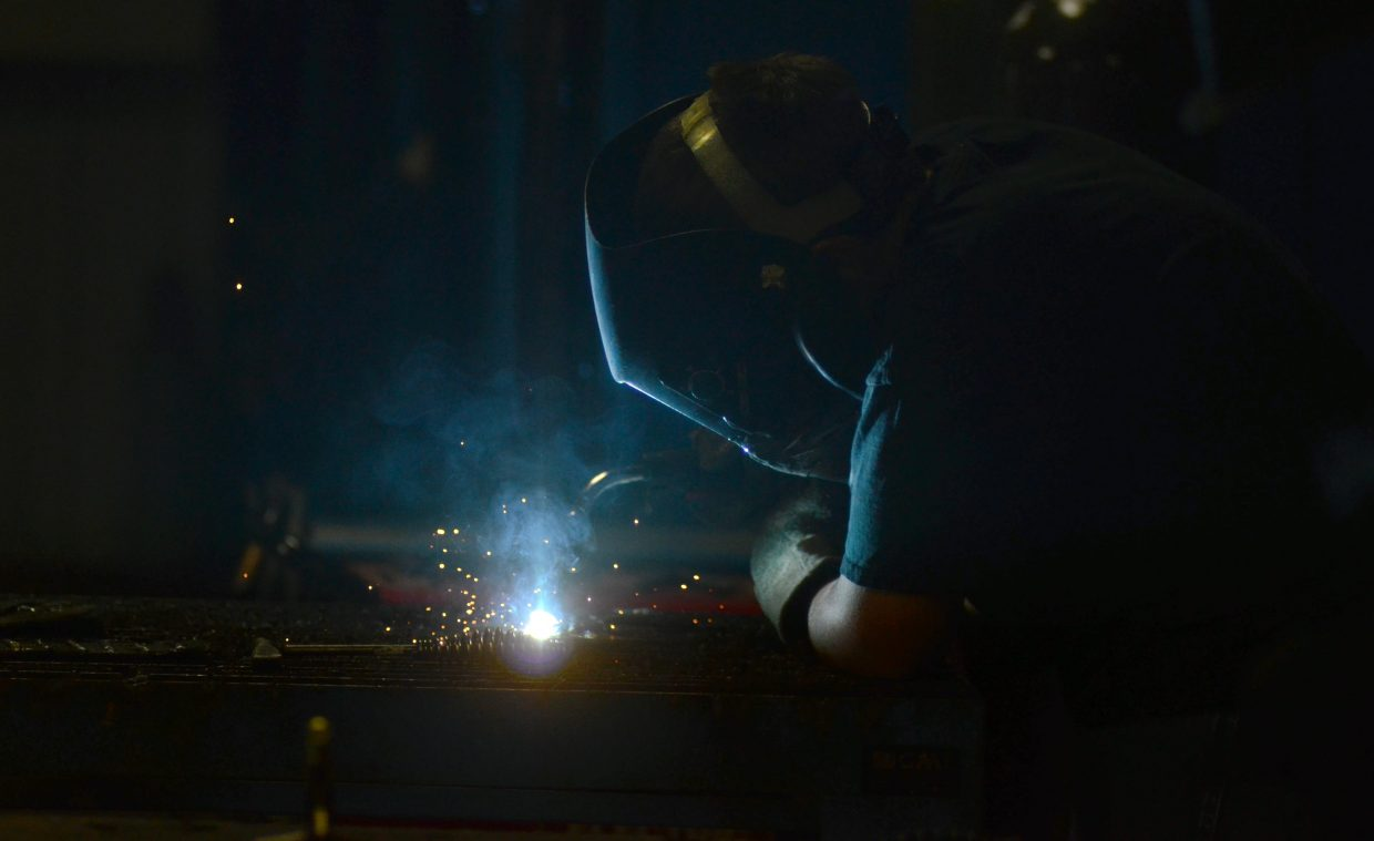 Soroco High School senior Kyle Veile works on a welding project in his power mechanics class. Around 15 students are currently enrolled in the school's concurrent enrollment program, earning college credits and working on an agriculture science certificate.
