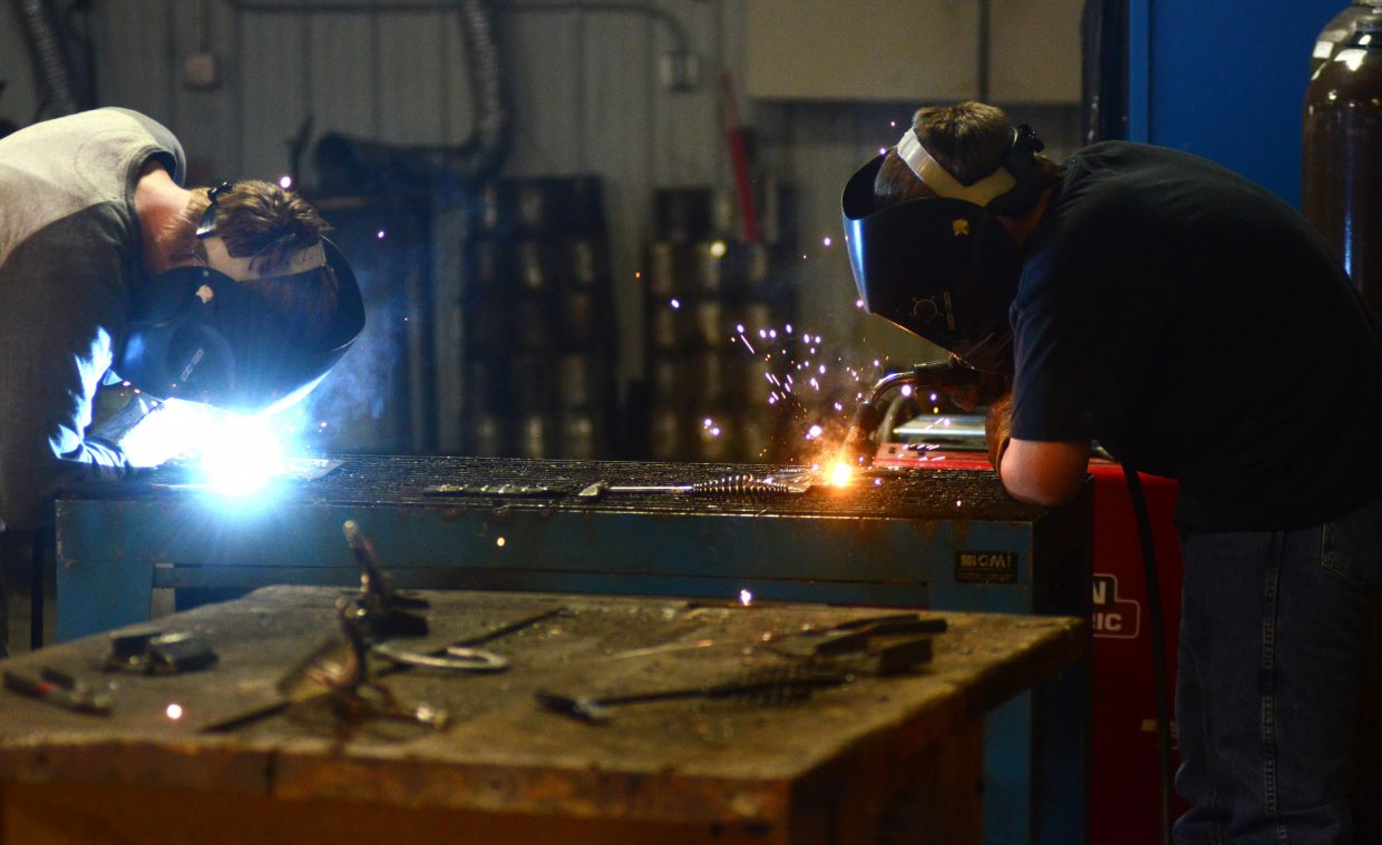 A pair of Soroco High School students get to work on welding projects in their power mechanics class. Thanks to big grants from the USDA and the Steamboat Springs Education Fund Board, students at the school can earn a certificate in agriculture science and get college credits in the process.