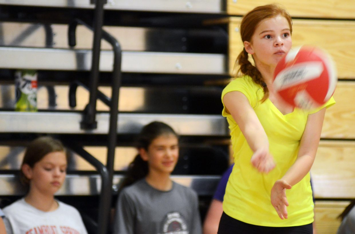 Steamboat Springs Middle School volleyball player Noelle Overstreet runs through a pressure serving drill in last Friday's practice. Every missed serve in the drill results in a wind sprint.
