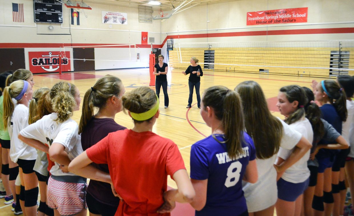 """When the Steamboat Springs Middle School volleyball team is called to """"corner up,"""" players must touch shoulders along the cornered lines and stay quiet while listening to coaches' instruction."""