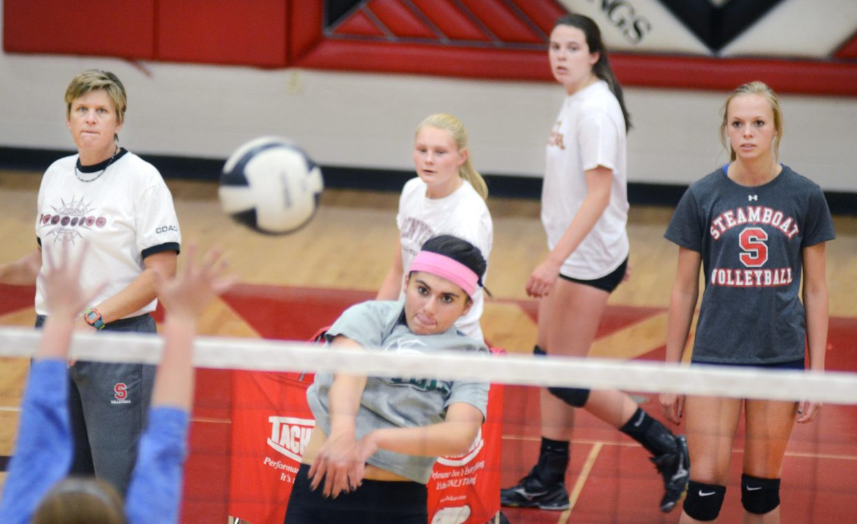 Steamboat Springs High School volleyball captain Maddie Labor hammers home a kill during a drill at Friday's practice with coach Wendy Hall and other Sailors looking on. Steamboat hosts No. 6 Montrose on Saturday in a big-time non-league contest.