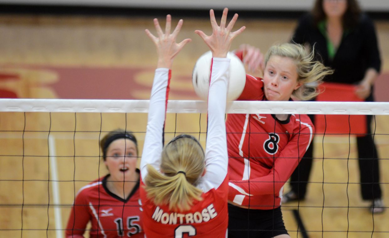 Steamboat Springs junior Riley Wilkinson has a kill denied by Montrose's Kellyn Alexander in the Sailors' 3-0 home loss Saturday.