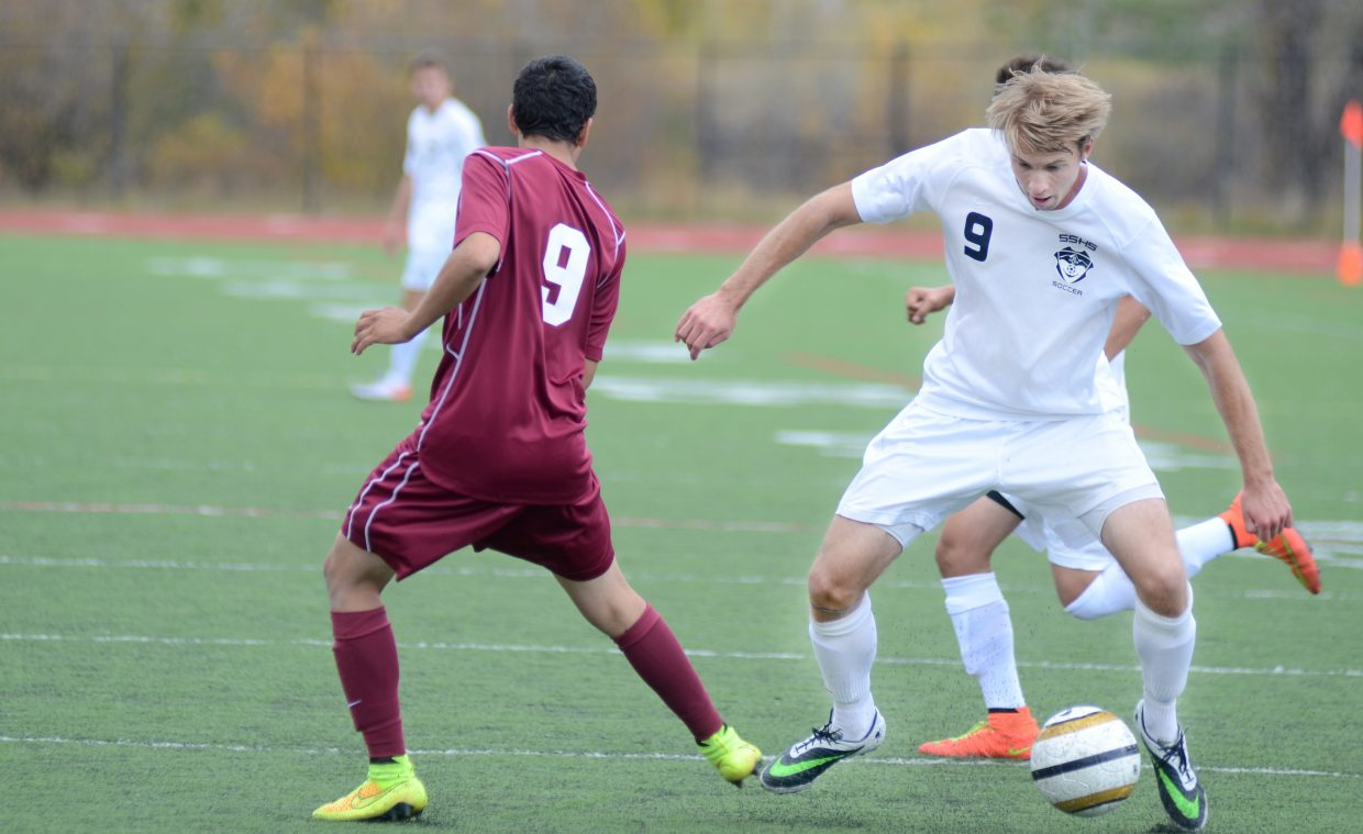 Steamboat Springs senior Nathan DePuy tries to free himself up from a pack of Palisade Bulldogs in the Sailors' shutout win on Saturday, 4-0.