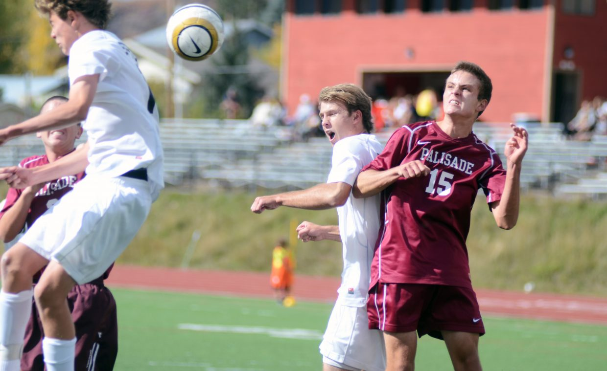 Steamboat Springs' senior Nathan DePuy goes in for a header against Palisade's Austin Stelmach near the Bulldogs' goal on Saturday. The Sailors used a strong second half to slide by Palisade, 4-0, on Senior Day.