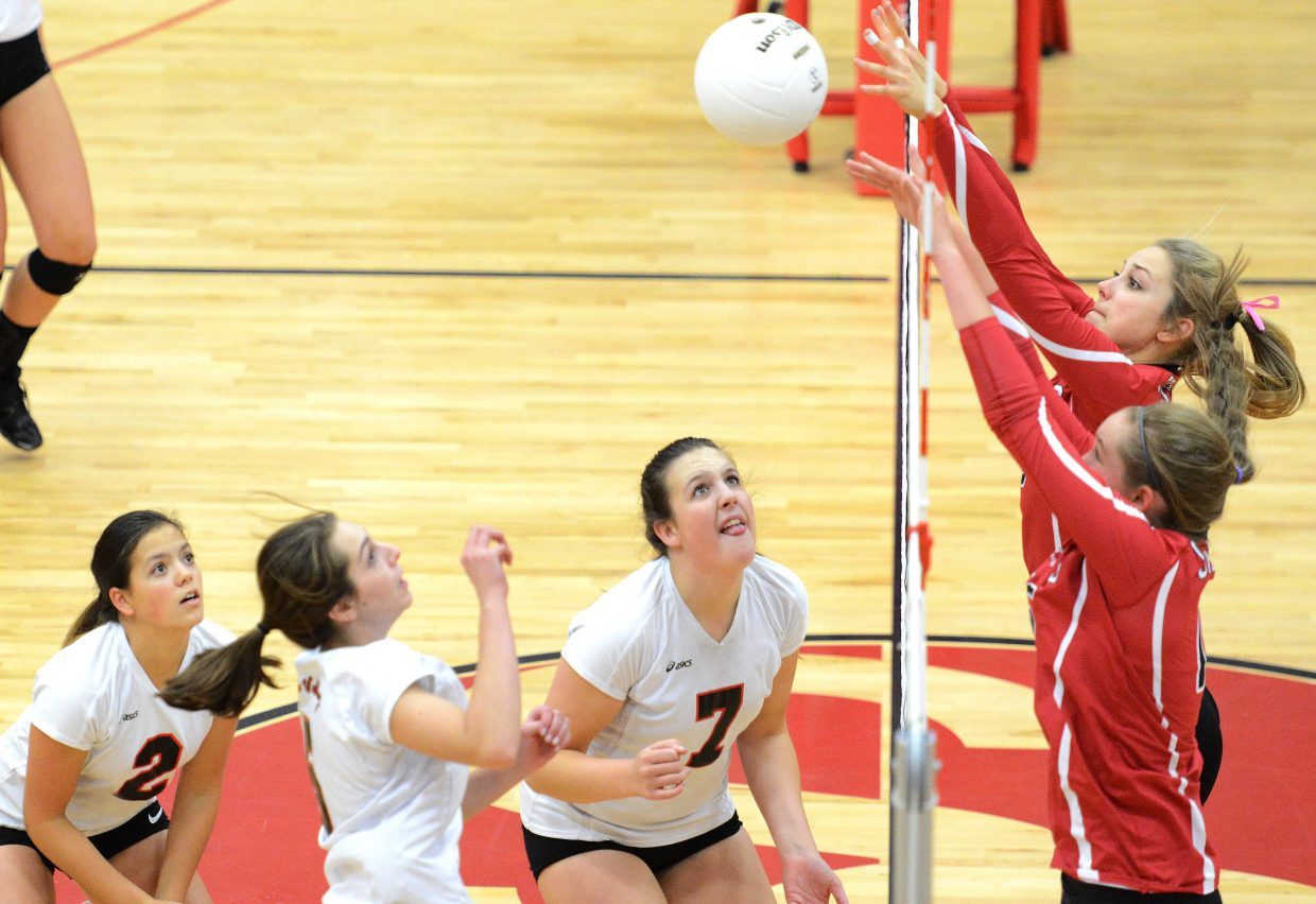 Steamboat Springs' Taylor Harrington and Jenna Miller go up for a block Saturday against Eagle Valley. The Devils downed the Sailors in a thrilling five-setter.