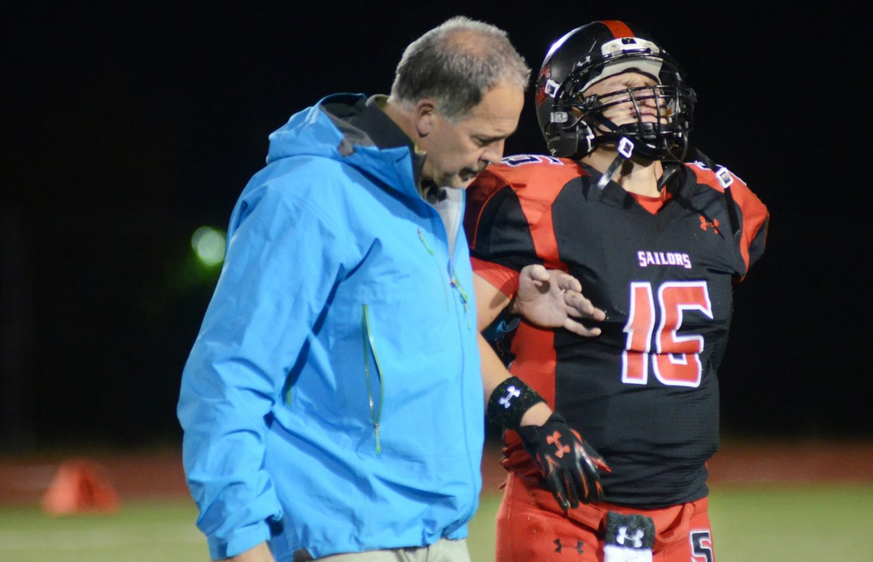 Steamboat Springs junior Zach Holm gets helped off the field after an injury in the third quarter of the Sailors' home game against Eagle Valley on Friday. After Holm's injury, the Devils racked up 19 unanswered points and beat Steamboat, 25-3.