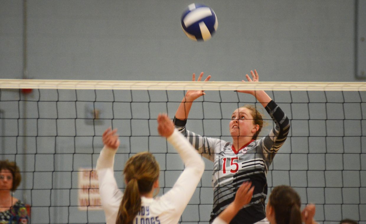 Steamboat Springs junior Jenna Miller soars high for a hit Thursday at Moffat County. The Sailors were able to push past the Lady Bulldogs, 3-1, to improve to 16-3 on the season.
