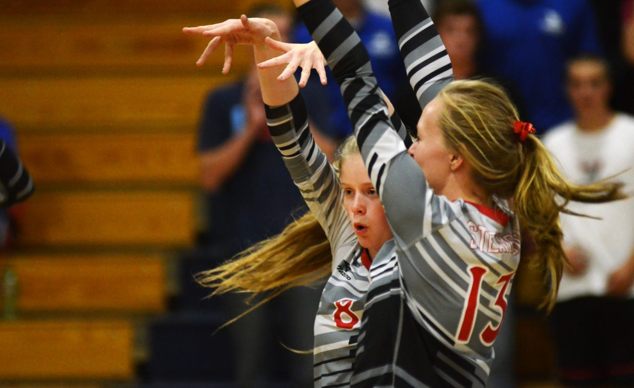 Steamboat Springs' Riley Wilkinson, left, celebrates a third-set block Thursday night in the Sailors' 3-1 win against Moffat County.