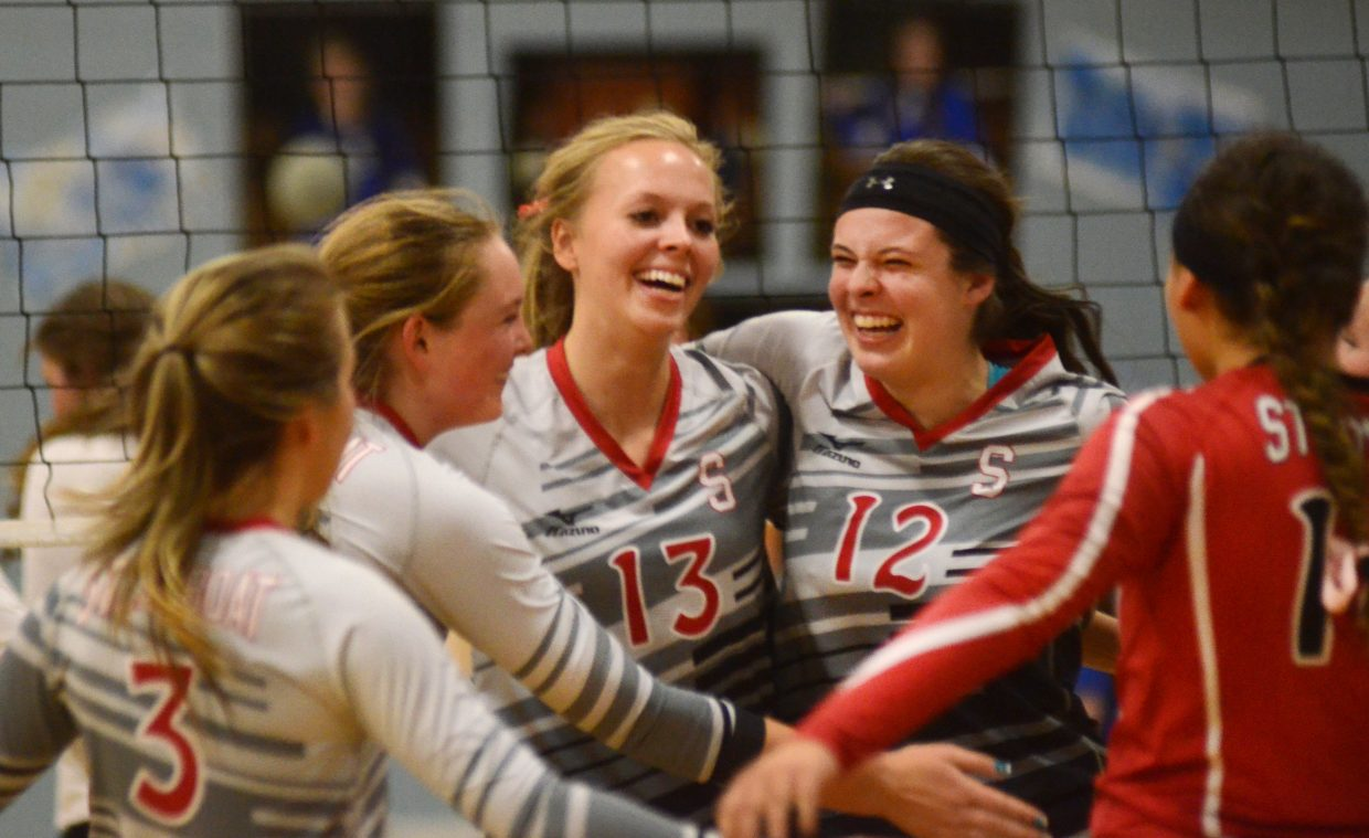 The Steamboat Springs High School volleyball team celebrates a four-set win against Moffat County on Thursday night. The Sailors overcame losing the opening set, cruising through the next three for the 3-1 win, improving to 16-3 in the process.