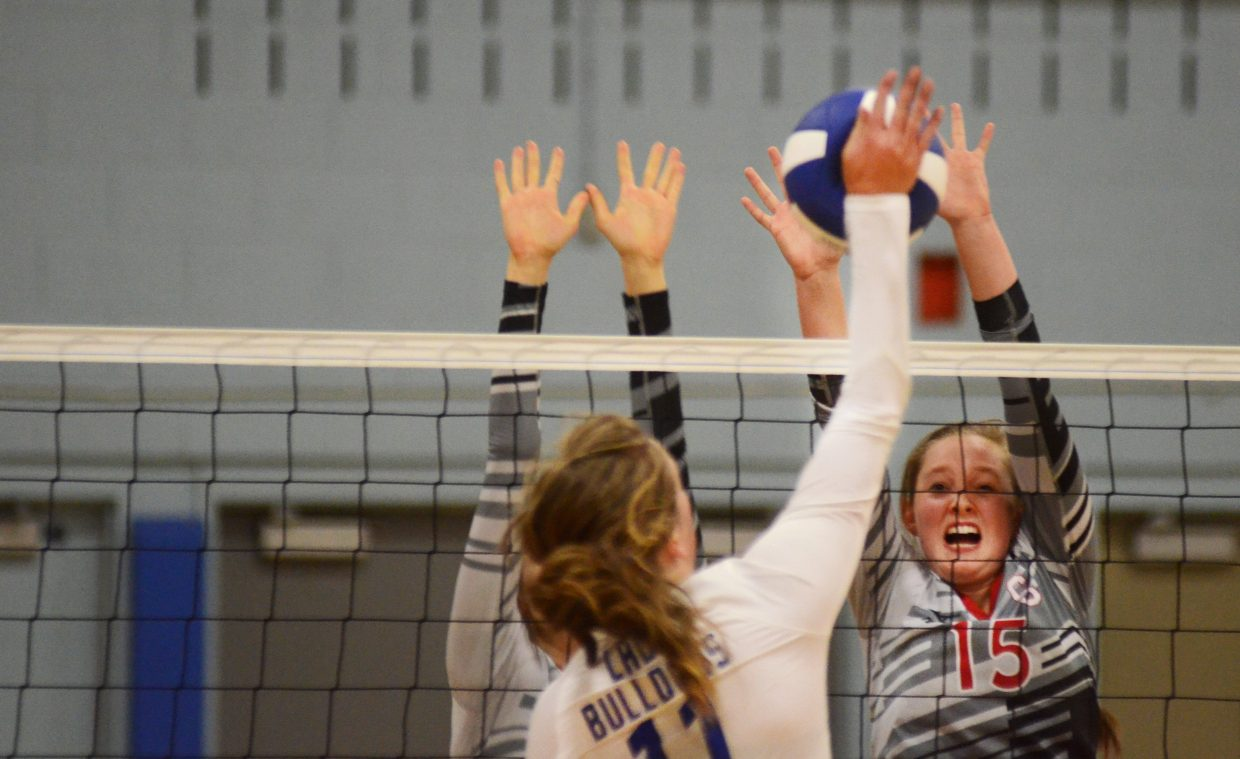 Steamboat Springs junior Jenna Miller braces for a block against Moffat County's Morgan Lawton on Thursday night in the Sailors' 3-1 win. With the victory, Steamboat has won the most games the program has seen since it won 17 in 2007.