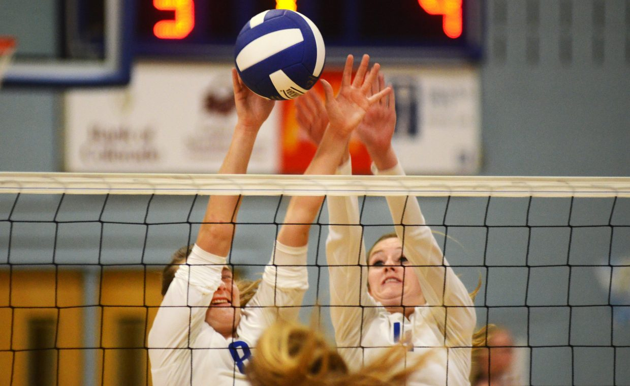 Moffat County's Britney Rothermund and Mattie Jo Duzik get up for a block Thursday in the Lady Bulldogs' 3-1 loss to visiting Steamboat Springs.