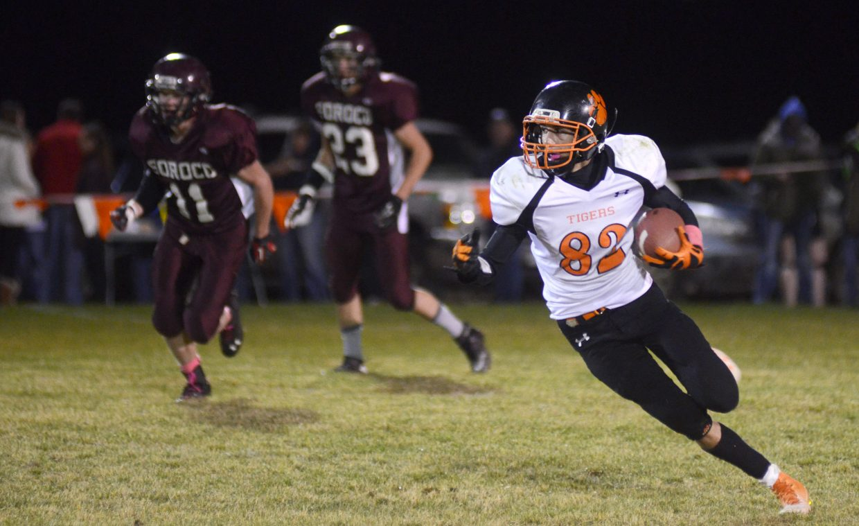 Hayden High School senior Tanner Guire turns the corner in the second half of the Tigers' 43-6 loss at Soroco on Friday night. It was Hayden's season finale.