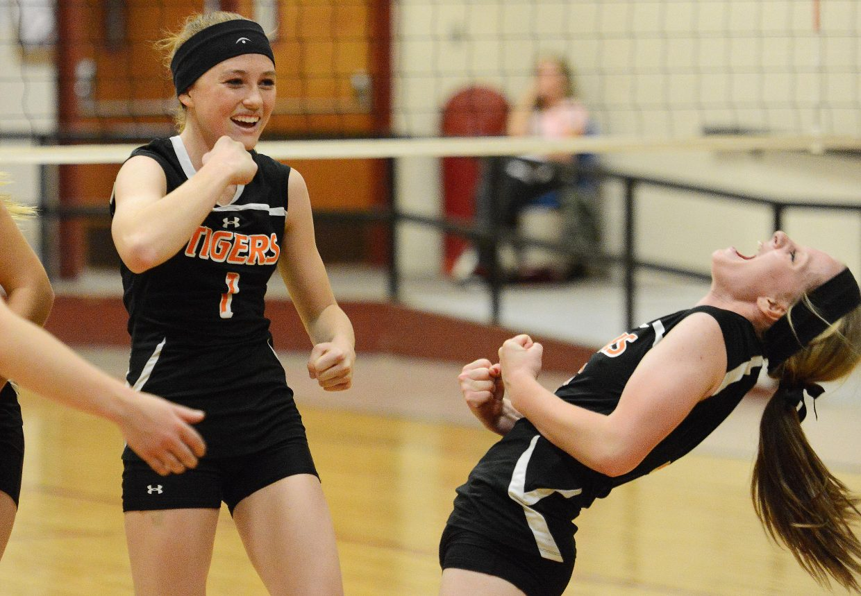 Hayden High School volleyball players Darian Murphy, left, and Grace Wilkie celebrate the Tigers' big win against rival Soroco in Friday's district tournament, avenging a pair of regular-season losses to the Rams in the process.