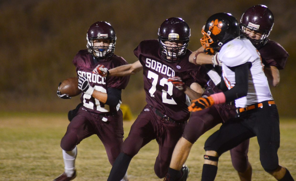 Soroco High School junior Storm Veilleux turns the corner on the Hayden defense in the Rams' 43-6 win versus the Tigers on Friday night. It proved to be Soroco's final game of the season after not being selected to the 8-man playoffs Sunday.