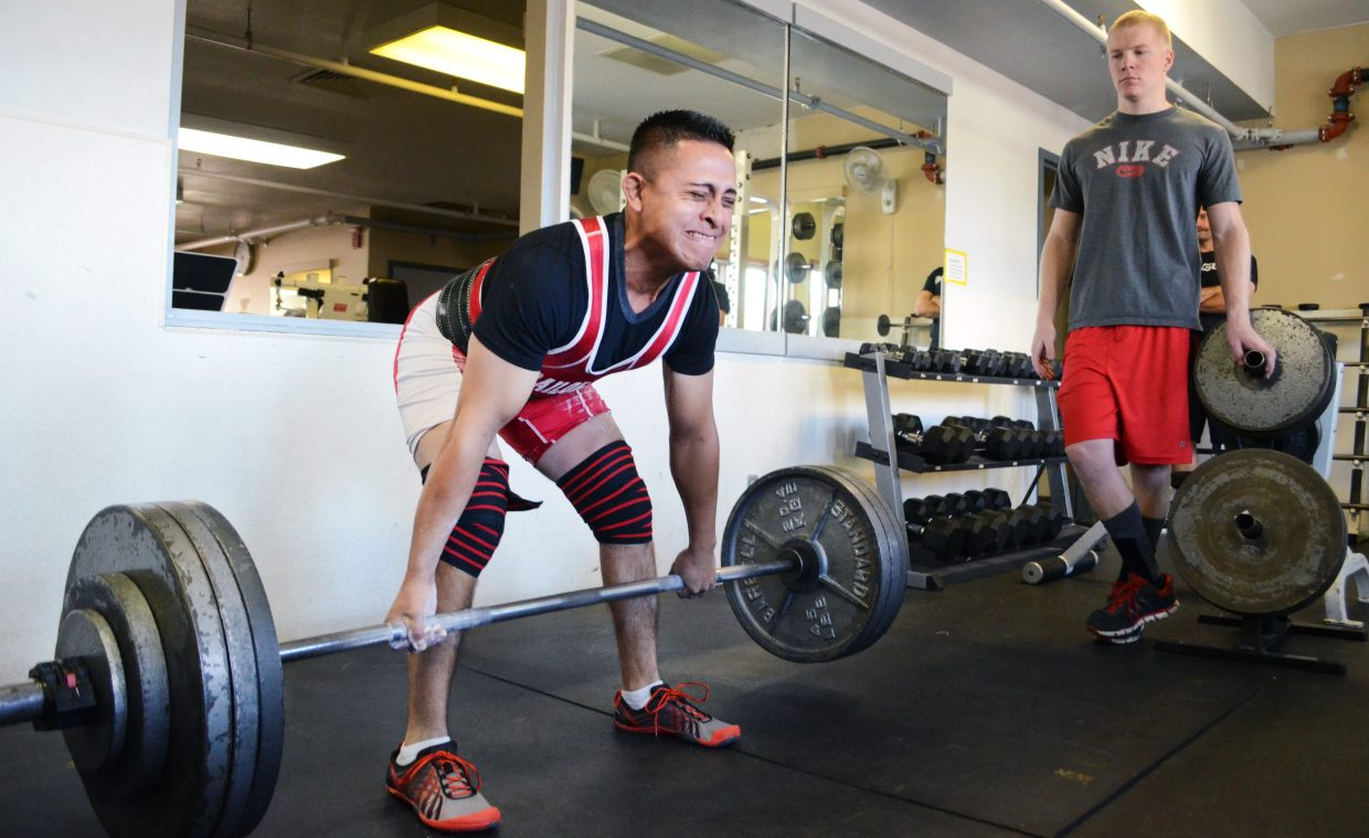 Rodrigo Flores, 27, tries to dead lift 385 pounds but couldn't lock it out Sunday during the Old Town Hot Springs' fall powerlifting meet. Flores did finish with a 365-pound dead lift, and a three-lift total weight of 940 pounds to win the meet.