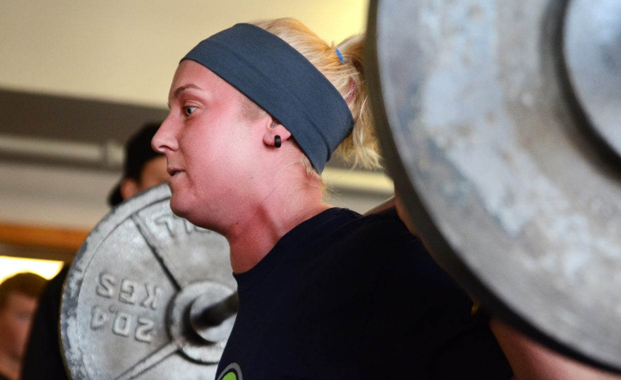 Courtnay Browne, 31, squats 145 pounds, her best squat of the day during Sunday's powerlifting meet at Old Town Hot Springs. Browne had a three-lift total weight of 460 pounds.
