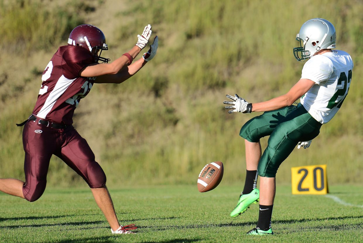 Soroco High School's Micah Gibbons gets airborne to block a Plateau Valley punt during the Rams' 44-22 win Sept. 6 in Oak Creek. Led by coach Josef Keller, the Rams went 5-3 and narrowly missed the 8-man playoffs.