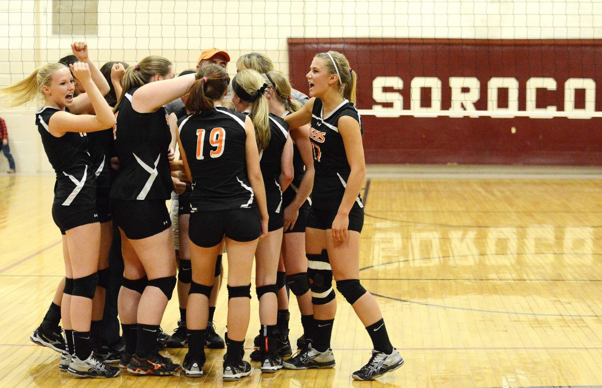 The Hayden High School volleyball team celebrates its big win against rival Soroco during the district tournament in October. The Tigers had a rough season, going 6-14 overall, but their sweeping win against the Rams to close out the season marked a big positive heading into 2015.