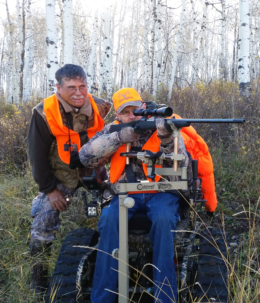 Outdoor Buddies President Larry Sanford, left, helps member hunter Sam Lomen, of California, line up a shot on a bull elk a few weeks ago near Twentymile Coal Mine. The three-decade-old nonprofit helps disabled members like Lomen fulfill their outdoor dreams by setting up buddy hunts. Outdoor Buddies has about 800 members spanning 39 states and all hunts are done in Colorado on primarily private land.