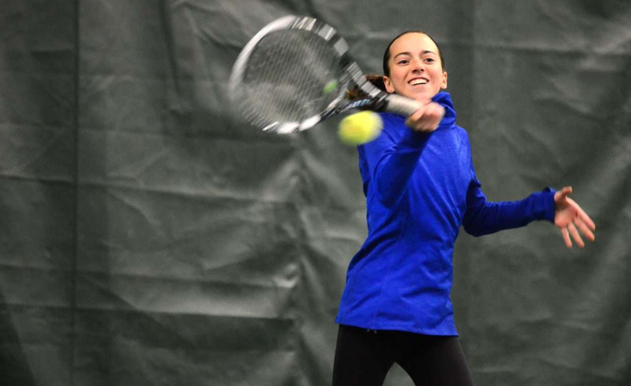 Steamboat Springs High School freshman Tatum Burger returns a shot Sunday in her final match against Caryn Mielke at the Steamboat City Singles and Doubles Tennis Championships. Burger easily won the women's 4.5 singles, dropping just three games in her three matches.