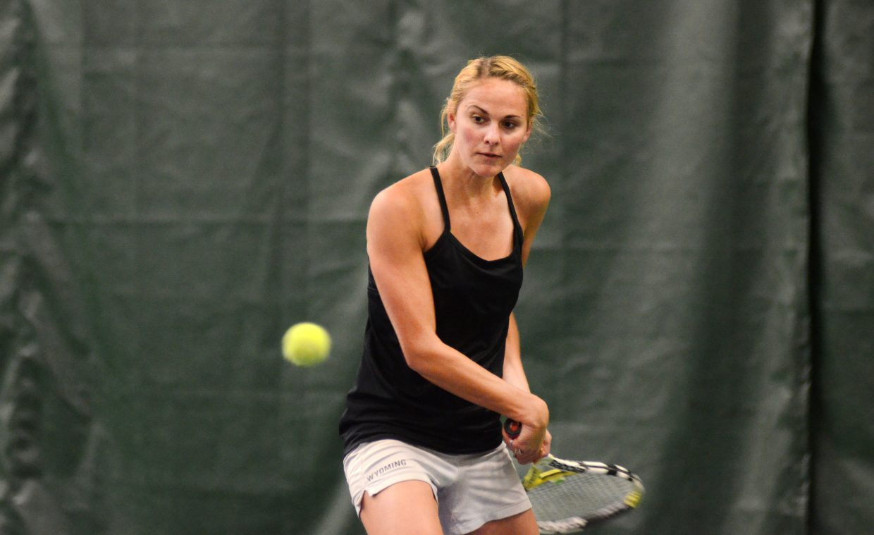 Caryn Mielke eyes a forehand return Sunday in her women's 4.5 singles match against Tatum Burger. Mielke lost the match, 6-0, 6-0.