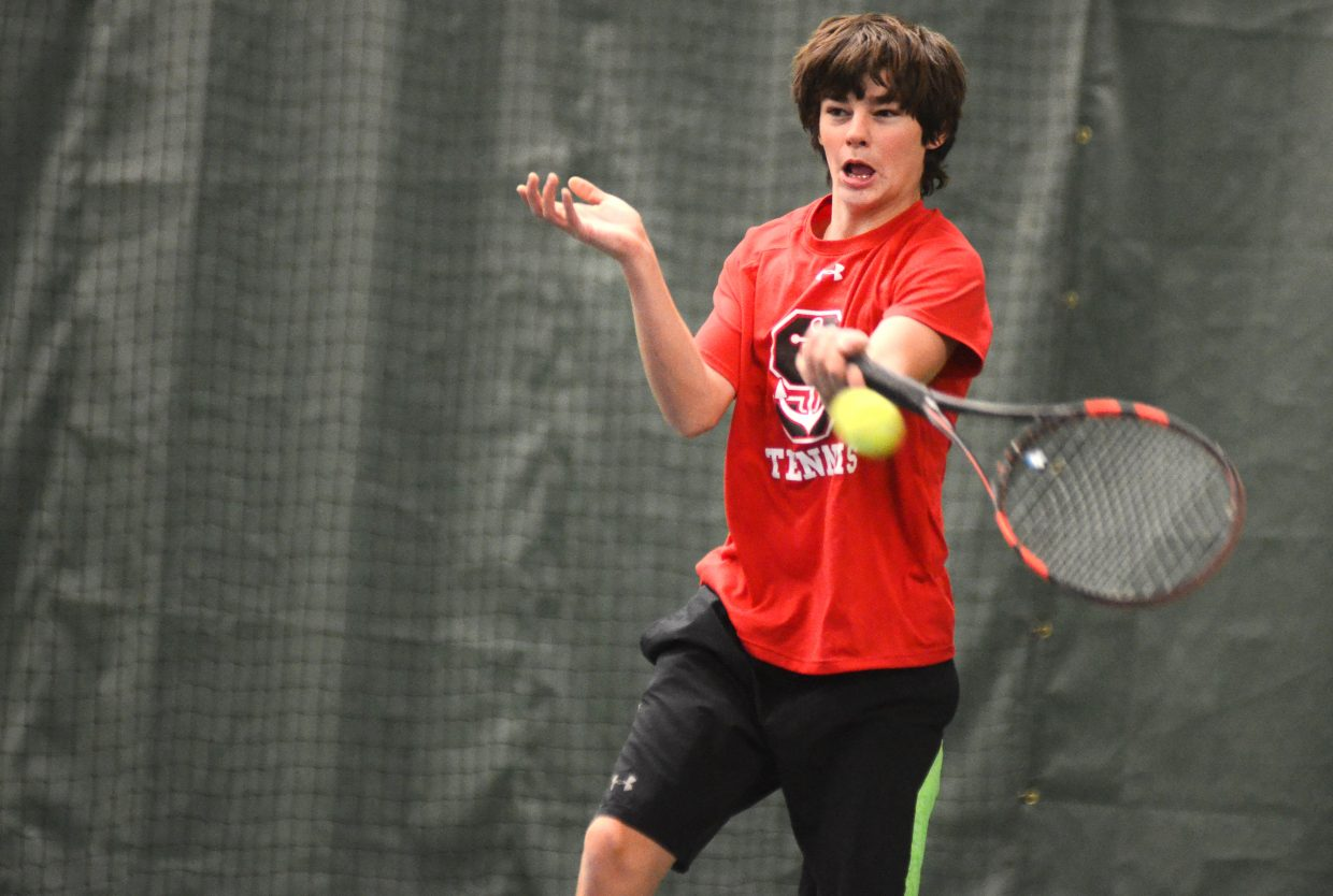 Playing alongside his dad, Tony Connell, Nolan Connell reaches for a return in Sunday's Steamboat City Singles and Doubles Championships. The Connells lost their 3.5 doubles match, 6-3, 6-1, to Kevin Cerone and Pete Woolverton.