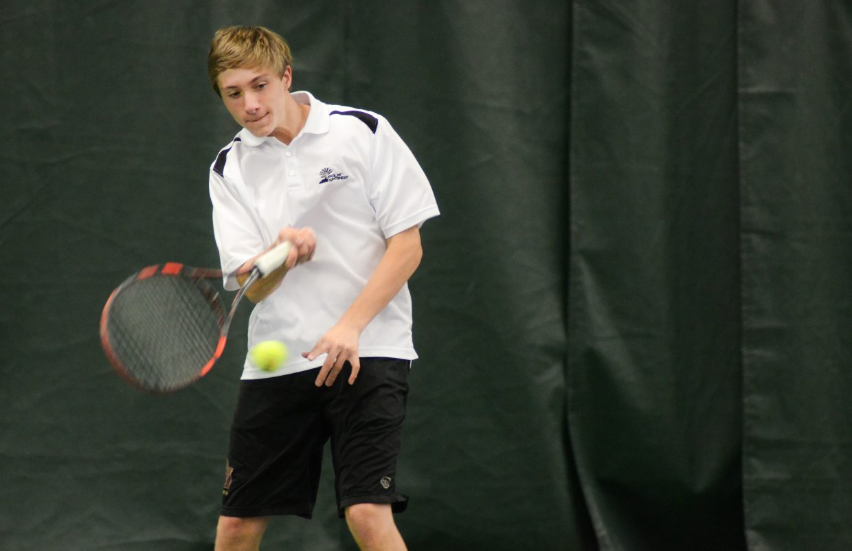 Steamboat Springs High School student Max Lynch gets off a shot in his men's 4.0 doubles match alongside Geoffrey Leaver. The duo lost the match, 6-1, 6-3, to Bo Stempel and Steve DeLine.
