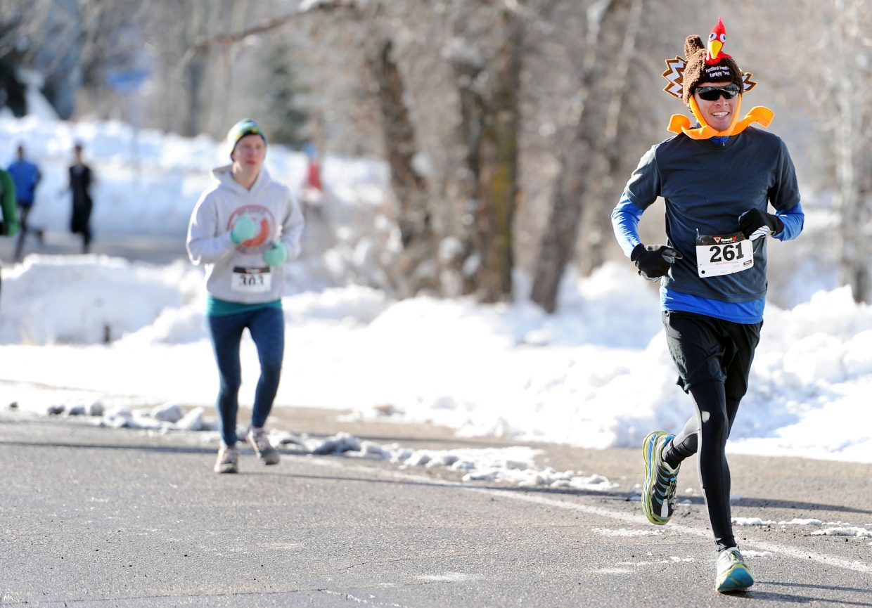"""Steamboat Springs' Pete Kalmes dons a turkey hat and a big smile mid-race at the 2014 Turkey Trot. What was Kalmes thankful for on Thanksgiving Day? """"I'm thankful for a beautiful day and just to live in paradise,"""" he said."""