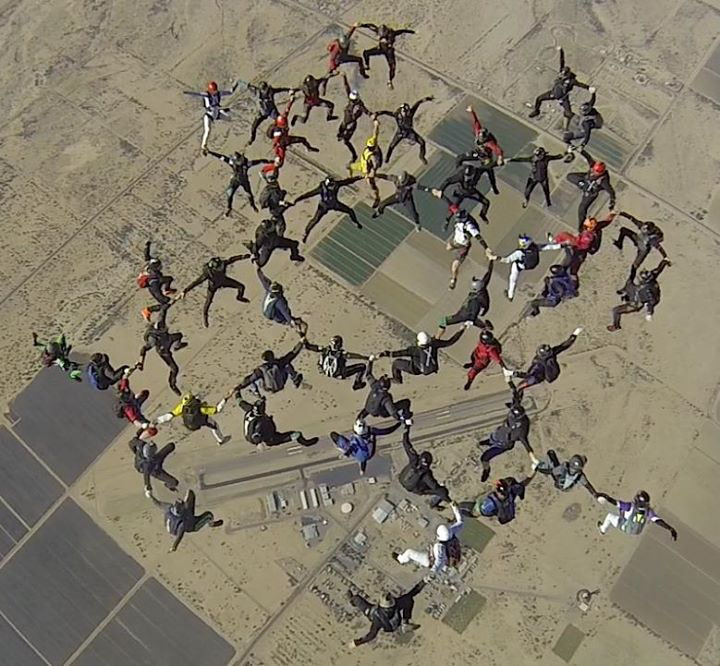 Joining together in very precisely drawn-up pods, 52 skydivers, including 1995 Steamboat Springs High School graduate Zachary R. Sabel, joined together to shatter the world record for upright formation jumpers.